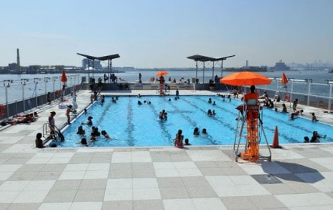 Guests play and swim at the floating pool in the Bronx