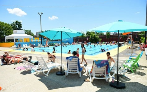 Guests enjoy the new lounge chairs and bright new colors at Douglass and DeGraw Pool in Brooklyn.
