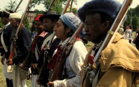 a group of men re-enact a battle scene