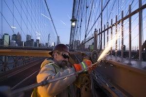 Department of Transportation employee performs maintenance on Brooklyn Bridge