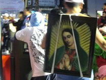 Religious pilgrim with image of the Virgin. Source: Chris Crews (Attribution via chriscrews.com)