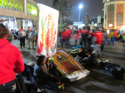 A group of pilgrims camped outside the Basilica of Our Lady of Guadalupe. Source: Chris Crews (Attribution via chriscrews.com)