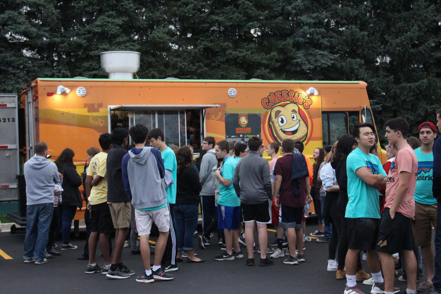 Students line up in front of Cheesie's food truck. Streetfest had a variety of food available including tacos, soul food, and bundt cakes.