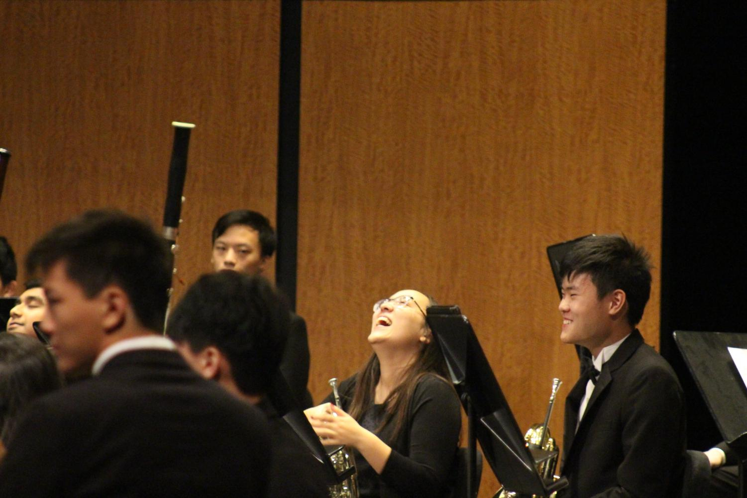 Miriam SIlberman '19 laughs during a break in the performance. Silberman is a member of band, but performed with Patriot Orchestra during the concert.