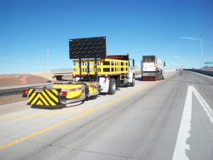 Attenuator service by Statewide Sweeping on highway.