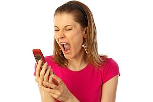 Mobile data roaming charges - woman in red screaming at mobile phone