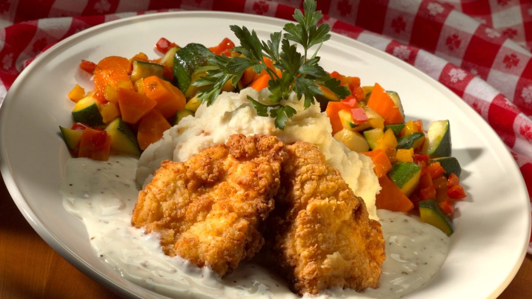 a photo of chicken tenders with veggies on the side