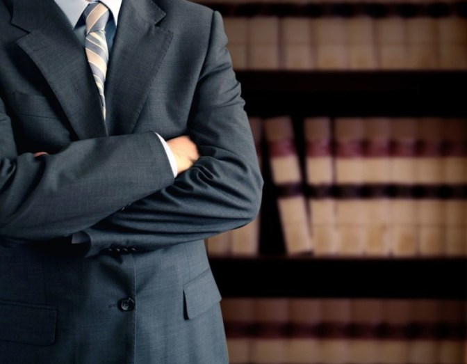 lawyer with his hands folded