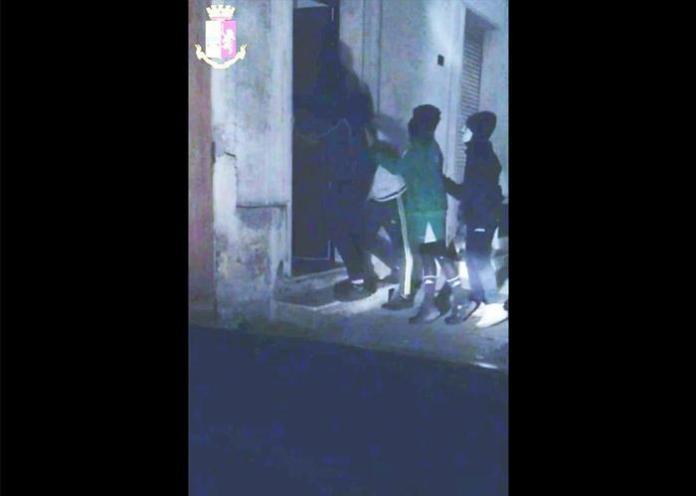 Fermo immagine del video della Polizia in cui si vede come il gruppo di otto ragazzi - sei dei quali minorenni - responsabile del pestaggio di Antonio Cosimo Stano, il pensionato 66enne di Manduria (Taranto) morto il 23 aprile, faccia irruzione nella casa dell' uomo con i bastoni in pugno e i volti nascosti da maschere. La polizia ha fermato oggi i ragazzi e la Procura contesta loro il reato di tortura e sequestro di persona. Manduria, 30 aprile 2019. ANSA/POLIZIA DI STATO