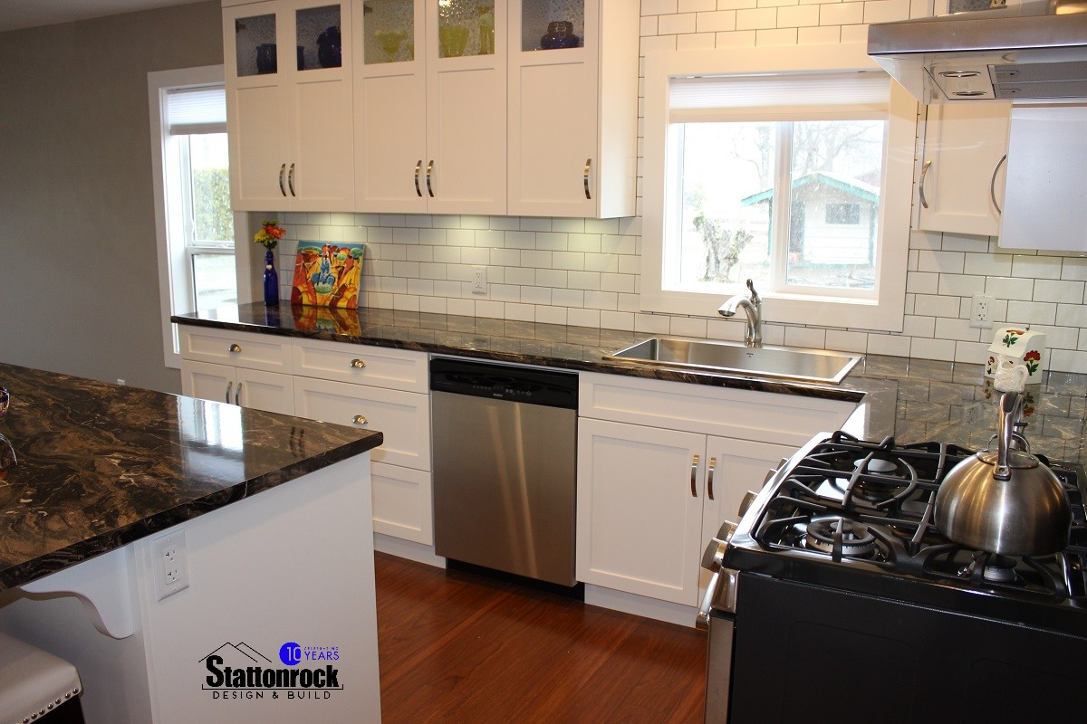 renovated kitchen stainless steel work table columbia renovation custom home builder renovations
