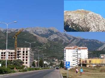 Pogled na Rumiju iz Bara, sa odsjajem metalne crkvice na vrhu