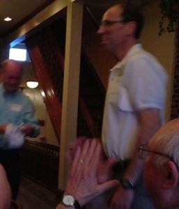 Al Brown looks on as chapter president Steve Adler and longtime member Donn DeBoard hand out awards