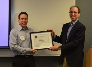 Todd DeLuca receives his award from STC PMC chapter president Steve Adler.
