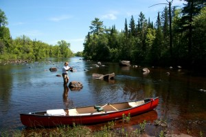 A canoe and fisherman on the upper St. Croix River