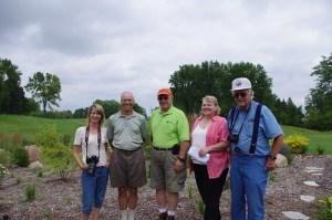 BCWD Manager Connie Taillon, SCC Member Paul Spilseth, BCWD Manager Craig Leiser, BCWD Manager Gail Pundsack and BCWD Manager Rick Vanzwol in front of a recently planted raingarden at Stillwater CC. (Photo courtesy Brown's Creek Watershed District)