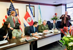 "Costa Rica SINAC Executive Director Rafael Guitiérrez and Christopher Stein, superintendent of the St. Croix National Scenic Riverway, sign a ""sister park arrangement"" between parks and protected areas of the Osa Conservation Area and Upper Midwest (NPS photo)"