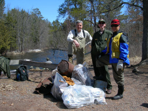 Participants and a pile of trash during the 2013 cleanup.
