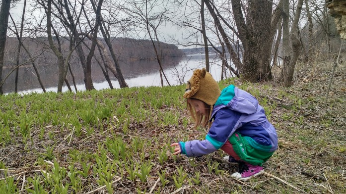 A girl examining new life at the Boom Site