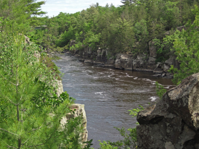 The view of the river shown above is from Angle Rock, a significant rocky promontory that marks the upstream end of a fault-controlled jog in the course of the St. Croix River. (Photo and caption by James St. John)
