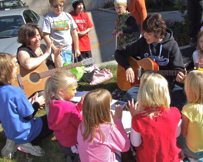 Kids and musicians at a previous AutumnFest. (Image via city of St. Croix Falls)