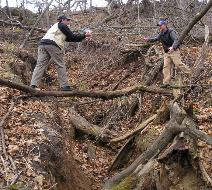 Measuring the gully in 2011. (Photo courtesy Carnelian-Marine-St. Croix Watershed District)
