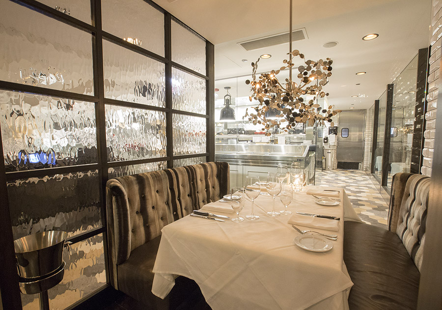 Semi Private Dining Suites Featuring Floor To Ceiling Glass Allowing Diners  A Great View Into The Kitchen.
