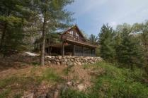 3 season room and expansive deck overlook a deep valley in the Kettle Moraine