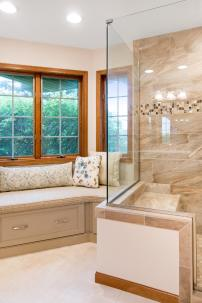 Large master bathroom with plenty of space for a large luxury shower and a bench for extra storage and seating.