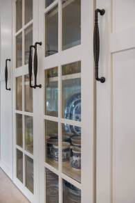 Decorative hardware in oil rubbed bronze on kitchen cabinetry.