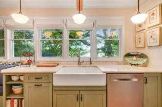 Apron front white farm sink with Caesar Stone quartz counters