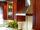 Kitchen with Built-in Curio Cabinet in Williams Bay - kitchen-range-hood-detail-640x480_c