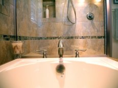 Master Bath with Soaking Tub in Delavan - tub-hardware-detail-640x480_c