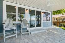Cement pavers under the screened in porch provide another outdoor living space