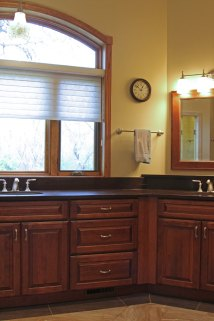 This spacious master bathroom has Medallion cabinetry with quartz countertops.