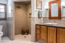 Large shower with multiple shower heads including a rain head shower.