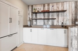 Kitchenette area with floating shelves for more storage.