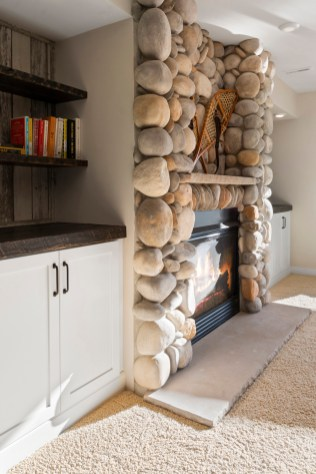 Built ins on either side of the fireplace with reclaimed barn wood detail.