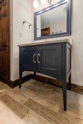 Navy blue vanity with Cambria quartz countertop.