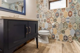 Tiled accent wall in cortino gives this bathroom an Italian feel.