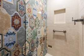 Many different styles of tile come together in this bathroom remodel.