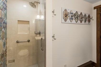 Frameless shower enclosure with single swing door