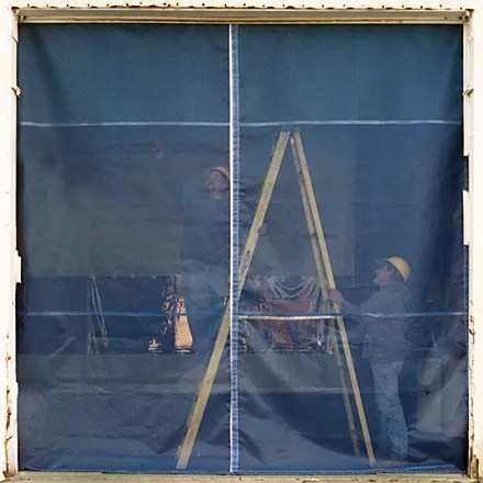 Industrial Mesh Curtain Door on Exterior of Warehouse Operation