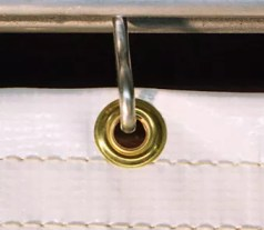 Brass Grommets used to hang industrial curtains securely on a rod.