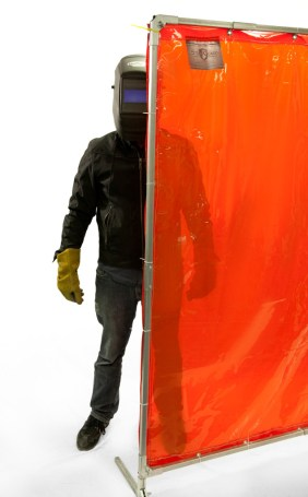 Welding Screen with Orange Weld-View Curtain Showing Transparency with Welder in Background