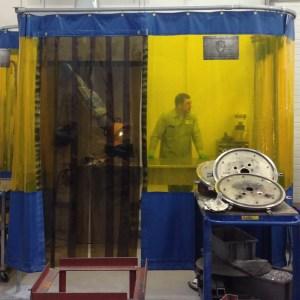welding curtains shielding a worker