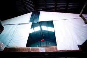 Loading dock curtains are fabricated with heavy-duty vinyl material