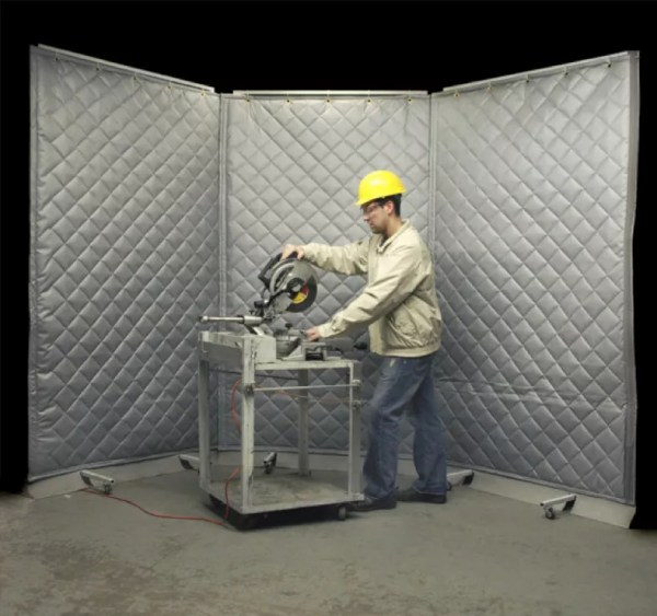 using a saw behind sound blocking curtains