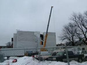 Vinyl Coated Tarp Protecting Construction Site