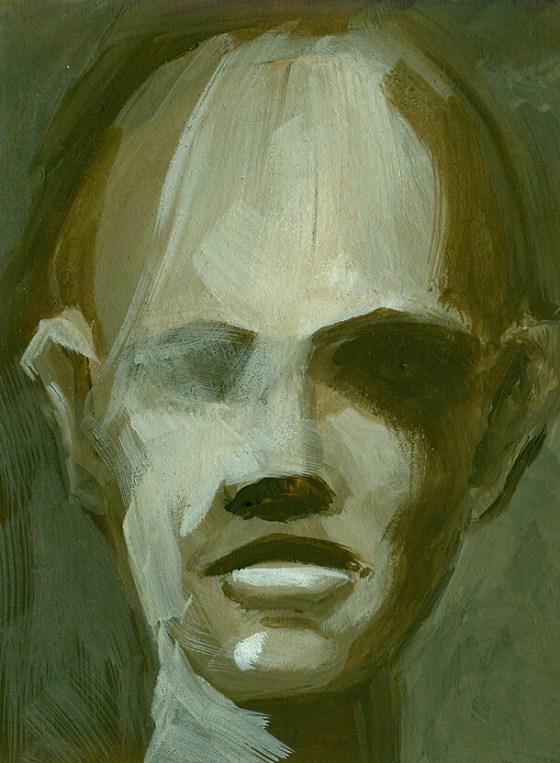 Il dipinto di un volto verde su cartone