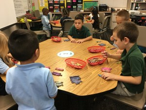 Students sorting crayons by colors